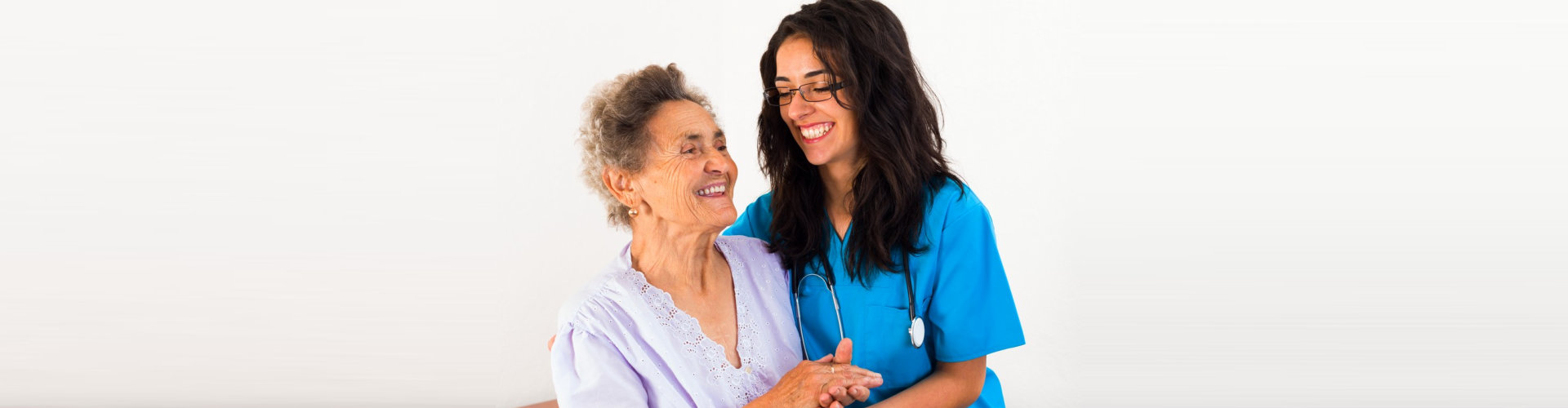 nurse and senior woman are laughing